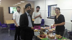 Ruby Jones pictured selling some delicious cakes to Tom and Adam from Ziylo, plus Jas from Auriga.